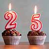 cupcakes with a 2 and 5 candle-Shutterstock